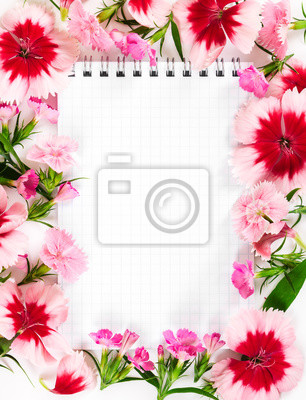 Notebook with flowers carnation on white background. Love concep