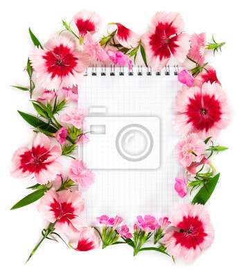 Notebook with flowers pink carnation on white background.