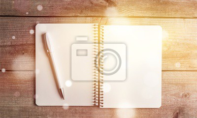 Notepad with pen on a wooden table blank break business copy
