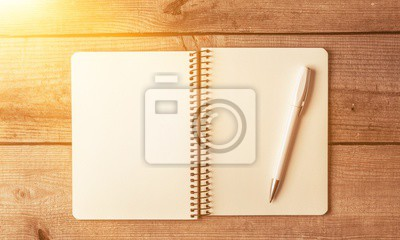 Notepad with pen on a wooden table blank break business copy copy space desktop