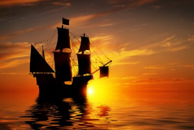 Wall mural Old ancient pirate ship on peaceful ocean at sunset.