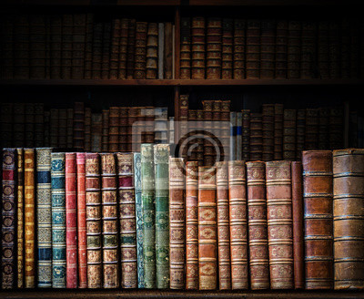 Old book on a bookshelf background. Selective focus. Science and education design concept.