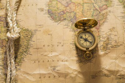 Wall mural old compass and rope on vintage map