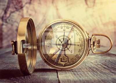 Old compass on vintage map. Retro style.