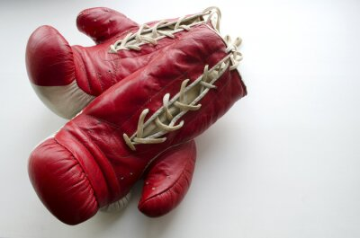 Wall mural old red and white boxing gloves on a light background
