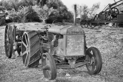 Wall mural Old rusted antique tractor detail in black and white