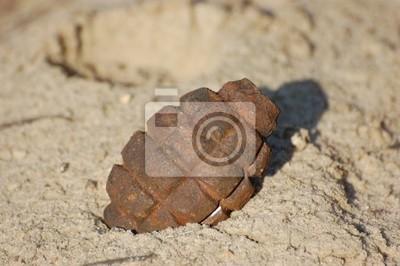 Old rusted World War II grenade