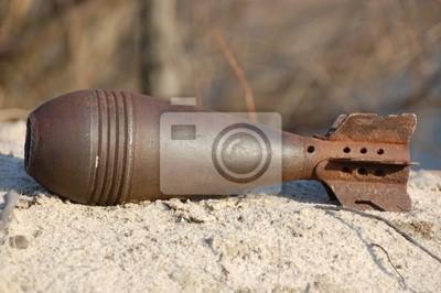 Old rusted World War II mortar shell