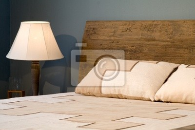 Old-style wooden bed with lamp