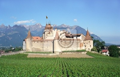 Old swiss castle under Alps mountains