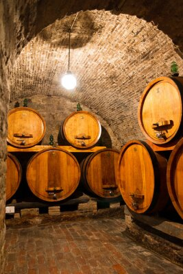 Wall mural Old traditional dark wine cellar with big wooden barrels