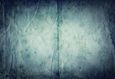 Old vintage blue paper background.