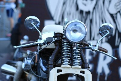 Wall mural Old vintage motorcycle with chrome accents and a headlamp