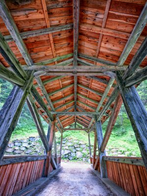 Wall mural old wooden covered bridge
