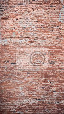 Old worn broken brick wall texture background