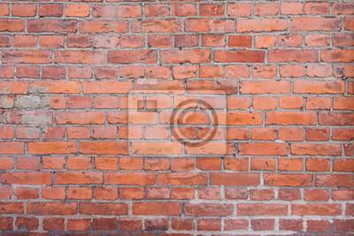 Old worn urban brick wall texture background