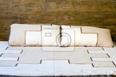 Oold-slyle wooden bed with pillows