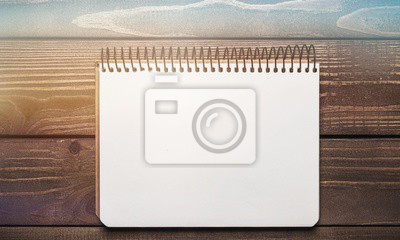 Open blank notebook with white paper on