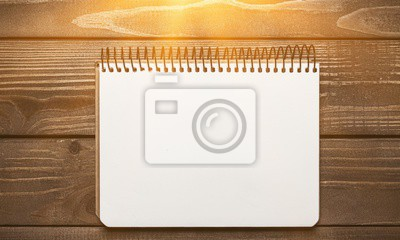 Open blank notebook with white paper on  background