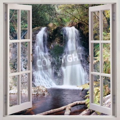 Wall mural Open window view to Hogarth Falls - a pleasant little waterfall nestled in the People s Park in the quaint coastal township of Strahan,Tasmania,Australia