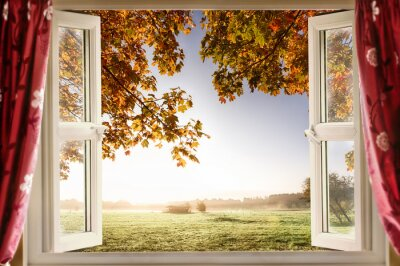 Wall mural Open window with fresh air and countryside scenery views. Red curtains opened show a modern window in a house in a rural location