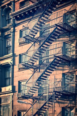 Wall mural Outside metal fire escape stairs, New York City, vintage process