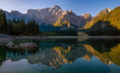 Panorama of an alpine lake on a beautiful sunny morning