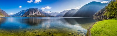 Wall mural Panorama of crystal clear mountain lake in Alps
