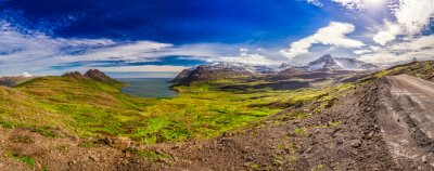 Wall mural Panorama of valley with the Arctic sea and the mountains in Iceland