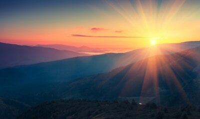 Wall mural Panoramic view of  colorful sunrise in mountains. Filtered image:cross processed vintage effect.