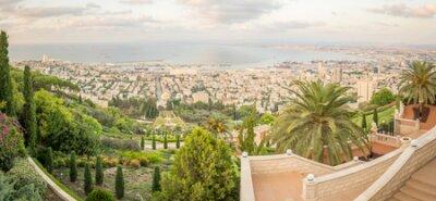 Panoramic view of the bay of Haifa, the Bahai Gardens and the port at sunset. Haifa, Israel
