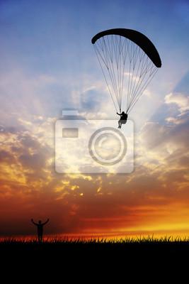 paraglider at sunset