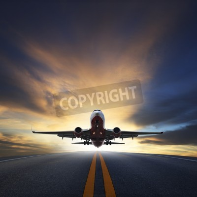 Wall mural passenger plane take off from runways against beautiful dusky sky with copy space use for air transport ,journey and traveling industry business