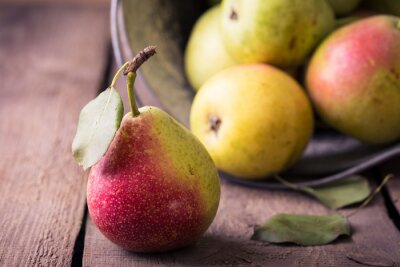 Wall mural pears on a wooden table