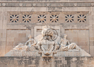 Pediment of old building is decorated with allegorical sculptures and bas-reliefs with  coat of arms of  Spanish king.