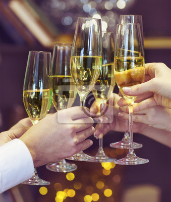 People holding glasses of champagne making a toast