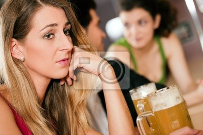 People in a bar, woman is sad and abandoned