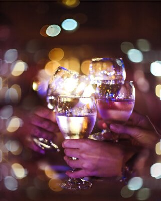 People toasting by wineglasses