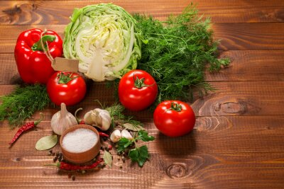Wall mural Pepper and tomatoes with garlic on a vintage wooden table with label