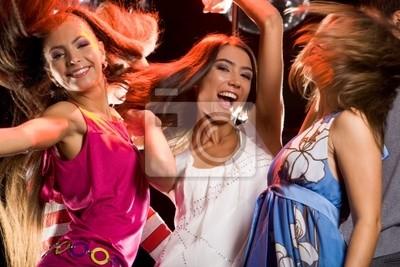 Photo of joyful teenage girls having fun on dance floor