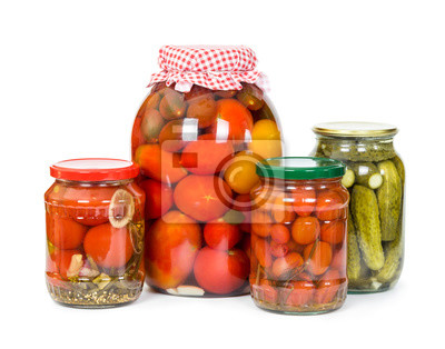 Pickled tomatoes and cucumbers  isolated on white