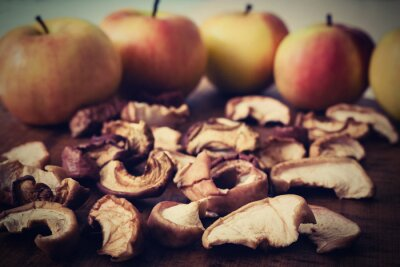 pieces of dried apple with apple background