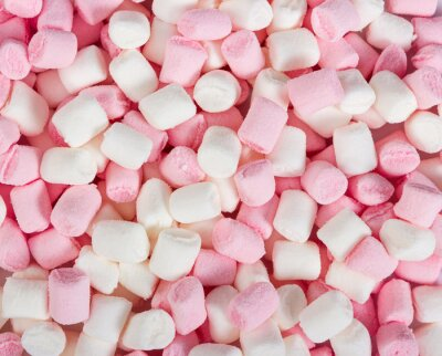 Pink and white mini marshmallows as background.