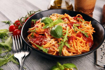 Wall mural Plate of delicious spaghetti Bolognaise or Bolognese with savory minced beef and tomato sauce garnished with parmesan
