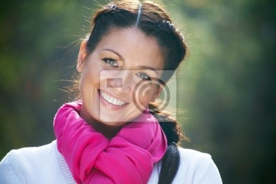 portrait of a beautiful young girl on a background of  park