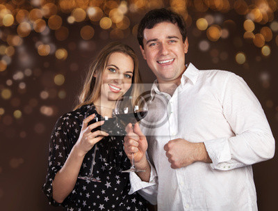 Portrait of a happy young couple on blurred lights background