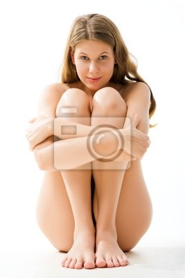 Portrait of sitting woman embracing her legs