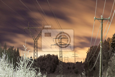 Wall mural Power lines and yellow clouds at night