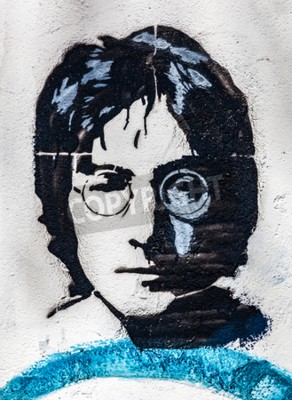 Wall mural PRAGUE, CZECH REPUBLIC - APRIL 29, 2016: John Lennon Wall, portrait. The wall has been filled with Lennon inspired graffiti and lyrics from Beatles' songs since 1980s as irritation of the communism
