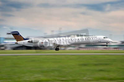 Wall mural PRAGUE, CZECH REPUBLIC - MAY 13: Eurowings Bombardier CRJ-900 NG lands at PRG Airport on May 13, 2015. Eurowings is a German low-cost airline based in Dsseldorf.